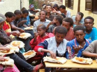 Streetchildren eating a daily meal provided by LIA church partners